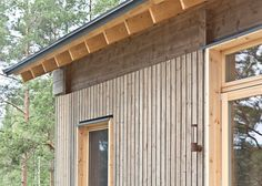 Sini Kamppari's cabin features slatted timber siding and projecting terrace