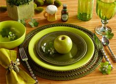 Just got the dark green plates at Pier 1 Imports in a square shape, to be topped with a yellow sunflower plate.