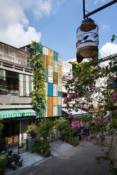 Facade of colourful shutters allows light and wind into Block Architects' Vegan House.