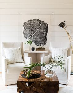 Rustic living with linen seat covers, beautiful solid wood coffee table, wall panelling