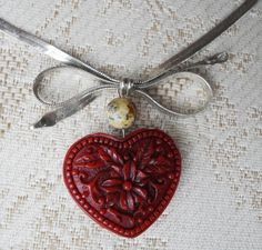 Hearts:  Vintage sterling silver and carved cinnabar #heart necklace.