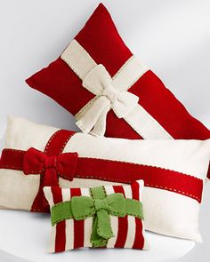 Wrap up your holiday decorating with whimsical knit pillows topped with knit ribbon bows to look like presents (and they make great gifts too).