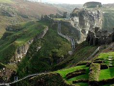 Tintagel Castle in Cornwall, England, is steeped in legend and mystery; it is said to be the birthplace of King Arthur and Merlin's Cave can be found nearby.