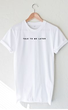 "- Description - Size Guide Details: Soft, unisex fit t-shirt in white with print featuring 'Talk To Me Later'. Brand: NYCT Clothing. 100% Cotton. Made in USA. Sizing: 34"" / 86.36 cm width 27""/ 68.58 c"