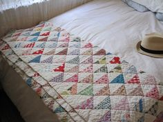 Half squares on point quilt (tutorial).  Great use of leftover fabrics, fat quarters or even to make a charm quilt.