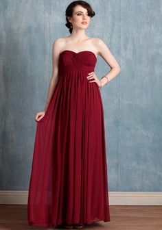 Hydrangea Burgundy Dress 145.99 . Reminiscent of origami folds, delicate ruched details lend artistry to this burgundy maxi dress in elegant georgette. Polished with a hidden back  zipper closure and a flattering empire waist.
