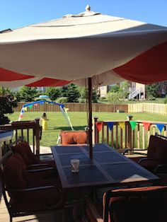 Circus/Big Top decorations- use plastic table cloths and binder clips to create a tent out of your patio umbrella!