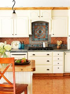 Combination Kitchen- This desert-inspired kitchen mixes warm terra-cotta  with cool blue