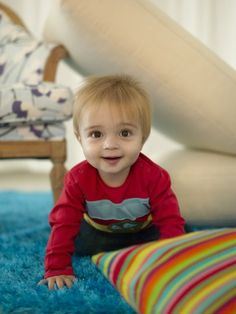 Build a fort with couch cushions and blankets for your toddler, he/she will love it!