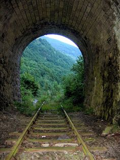 May be abandoned, but there's still light at the end of this tunnel. plus an amazing adventure to embark along with beautiful views. Abandoned Train, Abandoned Buildings, Abandoned Places, Train Tunnel, Old Trains, Train Tracks, Covered Bridges, Railroad Tracks, Beautiful Places