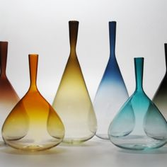 Aurora-Bottles- put it on top of the entertainment center? Love the grey, red and burnt orange.