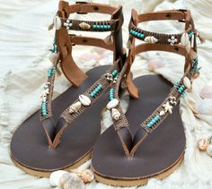 Genuine leather sandals handmade decorated with turquoise, silver sterling beads and shells  You can decorate your hands, ears, neck- but also …