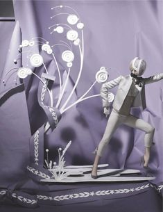 Vogue UK enlisted Tim Gutt to create a paper fantasy based in the Olympics 2012.