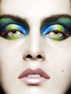 I <3 The Orange Lashes. Blue and Green Eye Makeup idea with Orange and Yellow Mascara to Really Bring Out Green Eyes.