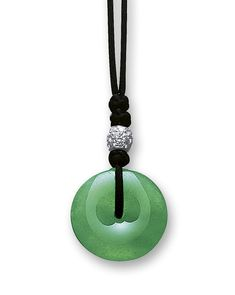 JADEITE 'HUAIGU' AND DIAMOND PENDANT    The translucent jadeite of emerald green colour carved as a huaigu, surmounted by a bead set with brilliant-cut diamonds, accompanied by a black cord, mounted in 18 karat white gold, length approximately 600mm.  Huaigu approximately 28.09 x 3.09 x 6.46mm. LOT SOLD. 1,580,000 HKD