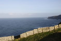 Liscannor stone forms a boundary wall at the Cliffs of Moher , built century Boundary Walls, Stone Masonry, Dry Stone, Cliffs Of Moher, Ireland, Irish, Tours, Building, Water