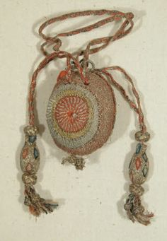 needlework techniques suggest an earlier date than the 1750-1760 given, though that is a pretty close time-line... appears to be fingerloop braid drawstrings, soutache wrapped tassels, as 16/17c sweet bags