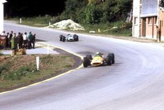 Denny Hulme leads Jackie Stewart past the pub in Burnenville at the 1968 GP of Belgium Circuit de Spa-Francorchamps
