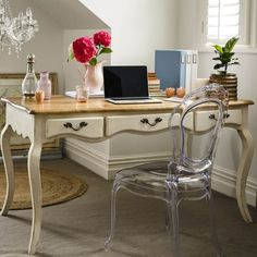 The elegant Provincial Oak collection combines French provincial sensibilities with Parisian chic, matching durable solid oak tabletops with a hand finished, distressed underframe, in your choice of black or white.