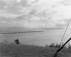 Robert Adams: West From The Columbia - Southeast from Cape Disappointment, in Washington,  across the Columbia River to Oregon, 1990, gelatin-silver print
