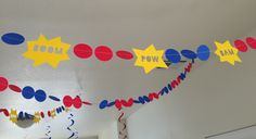DIY super hero party garland.  Shapes cut wit my Silhouette and sewn together with a sewing machine.