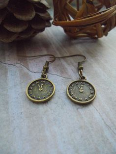Check out this item in my Etsy shop https://www.etsy.com/uk/listing/272373010/vintage-bronze-clock-charm-earrings