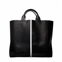 """Black and white tote in python with taped seam. Front and back hanging pockets with hidden magnetic snap closure. H: 13.5"""" W: 15.5"""" D: 5""""Handle Drop: 5.5"""" Thi"""