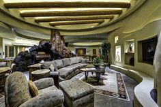 Living room built around a boulder