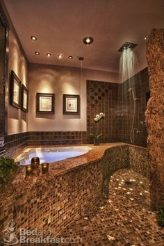 This is my dream bathroom I think. I love the shower head in the ceiling idea one of my favorites.