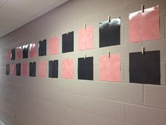 Laminate construction paper and hot glue it and a clothes pin to the wall to display student work without having to use tape each time it changes.