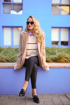 sweater with pink button down shirt and blazer with loafers and straight leg pants