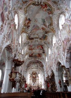 Rottenbuch Abbey was constructed between 1085 and 1125 in the Romanesque style. In the 18th century the medieval interior of the church was redecorated in the ornate High Baroque style by painter Matthäus Günther and stuccoist Josef Schmuzer.