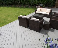 TimberTech's EasyClean Terrain+ Silver Maple composite decking has a stylish design and a protective sleeve to keep out moisture. Outdoor Spaces, Outdoor Decor, Composite Decking, Pool Decks, Easy Home Decor, Composition, Outdoor Furniture Sets, New Homes, Patio