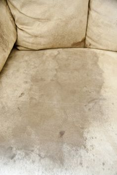 How to clean a microfiber couch....  Spray bottle, Rubbing Alcohol, light color sponge, white bristle brush - pour alcohol in spray bottle and saturate the stain, scrub area hard with sponge, dirt will start coming off on the sponge(use new sponge when it gets to dirty) let dry COMPLETELY. (it will look dark & hard) take the brush using swirling motions & fluff the areas
