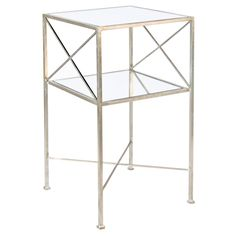 """Worlds Away Henri Silver Square Side TableSimple and chic, Henri marks the spot with X sides and stretcher connecting its slender silver leaf frame. Inset mirror tops the two tiers of this glamorous Worlds Away side table. 15"""" Sq x 28""""H Silver leaf finish 2 mirrored shelves"""