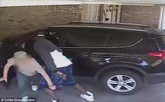 The victim is thrown to the ground as the robber attempts to search the car for money