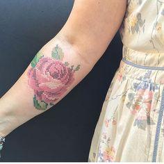 Cross-stitch rose tattoo.