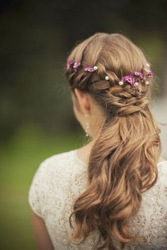 Crown Creation: If you choose to forgo a veil, this flower crown might spark your interest. Here, purple petaled flowers take center stage in an already envy-inducing braid.