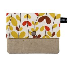 This handy little wallet has a cotton canvas cover, cotton lining and unbleached cotton/linen front panel. Feature fabric is on top flap and back of wallet, and the wallet is fully lined and lightly interfaced for extra firmness and durability. Features a snap fastener to secure your wallet closed. Measures approx 13.5cm x 10.5cm (5 1/4