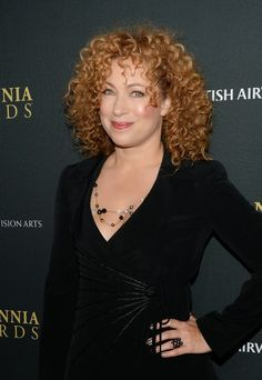 You can't have a board about curly hair without Alex Kingston!