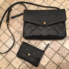 Louis Vuitton twinset - empreinte. Btw, as there's no D clip inside the bag, one can't clip on a key holder or coin purse