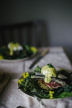ASPARAGUS BENEDICT ON QUINOA NETTLE CAKES WITH COUNTRY HAM, LOVAGE MINT AIOLI, AND A POACHED EGG