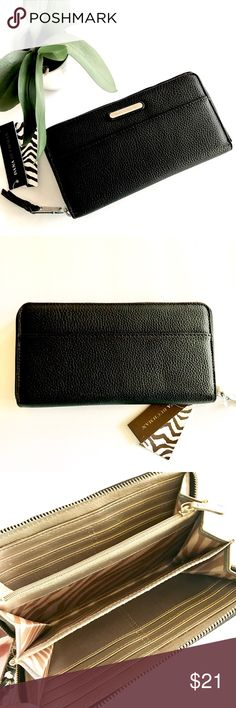 """🆕Dana Buchman Black Zip Around Wallet NWT Carry your essentials in style with this Dana Buchman wallet. Silver-tone logo & hardware, zipper closure. Black textured faux leather. Zebra print & pale gold accent interior.  ▪️Measures approx 4"""" x 8"""" x 1"""" ▪️Exterior: 2 slip pockets ▪️Interior: 12 card slots, 2 bill slots/slip pockets, 3 open compartments, center zip compartment  Note small rough spots in last 2 photos - reflected in price - visible only in some light, slightly raised to the…"""