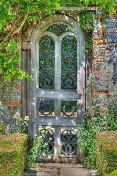 Weathered wood and wrought iron garden door