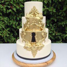 Gold keyhole wedding cake