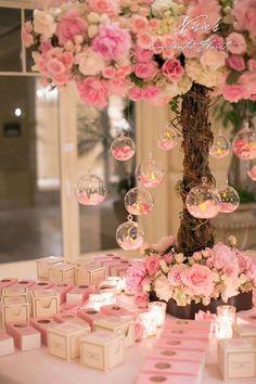 pink wedding centerpiece idea via Nisie's Enchanted Florist / http://www.himisspuff.com/tall-wedding-centerpieces/9/