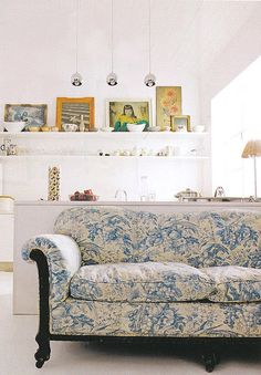 The shelves, the art and the unexpected pattern on the sofa. This is Shelley Street's home in Real Living magazine, scanned by Dust Jacket Attic. Photographed by Martin Hahn.