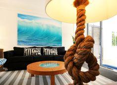 Rug idea for coastal living room. Nice pic and light too! Beautiful Armidillo rug.