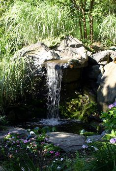 Natural Pondless Waterfalls in woods by Creative Land Design