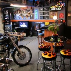 Even bikers deserve a man cave from the leather stools with flames to the Bike in the middle of the room. One look that can be easily inexpensively by searching through rummage sales, flea markets, junk yards, and even a few thrift shops.
